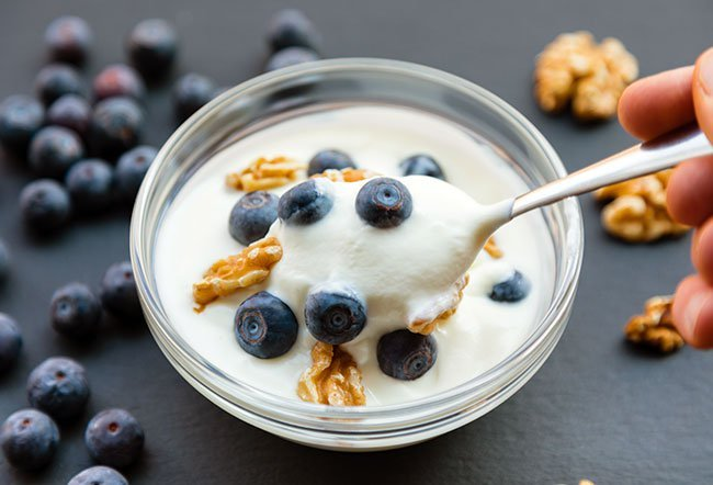 The United States Department of Agriculture (USDA) recommends three cup equivalents of dairy per day (including yogurt, cream cheese, low-fat milk) for those older than nine years of age. So, if people stay within recommended limits, yogurt will help keep them healthy.